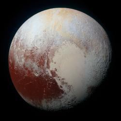 The Rich Color Variations of Pluto: Pluto's surface sports a remarkable range of subtle colors, enhanced in this view to a rainbow of pale blues, yellows, oranges, and deep reds.